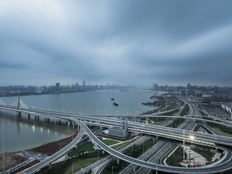 urban traffic road with skyline background  by unite images for Stocksy United
