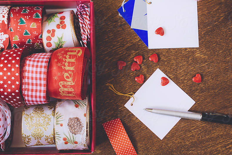Preparing Christmas presents and cards by Pixel Stories for Stocksy United