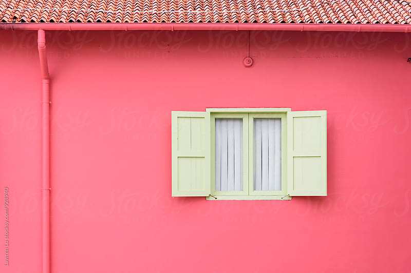 Window on pink wall with shutters by Lawren Lu for Stocksy United