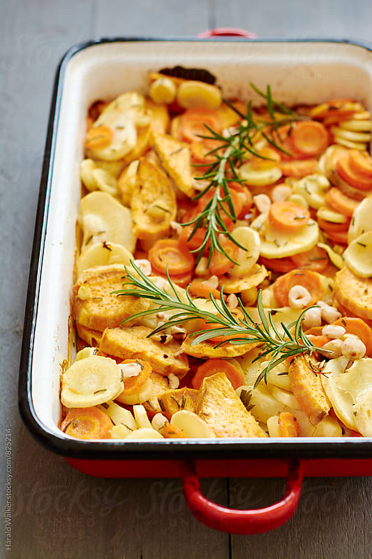 Roasted Parsnips, Carrots and Sweet Potatoes  by Harald Walker for Stocksy United
