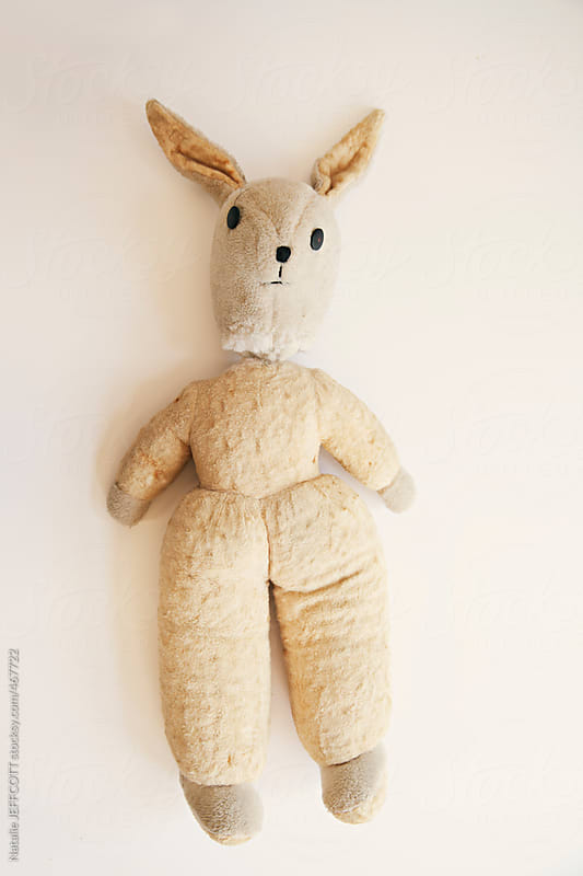 old and loved childhood teddy rabbit by Natalie JEFFCOTT for Stocksy United