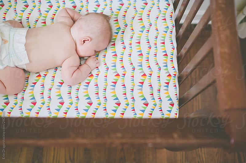 baby in crib by Erin Drago for Stocksy United