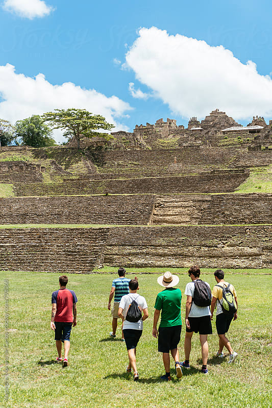 Group of six young men travelers walking together towards ancient pre-columbian ruins by Alejandro Moreno de Carlos for Stocksy United