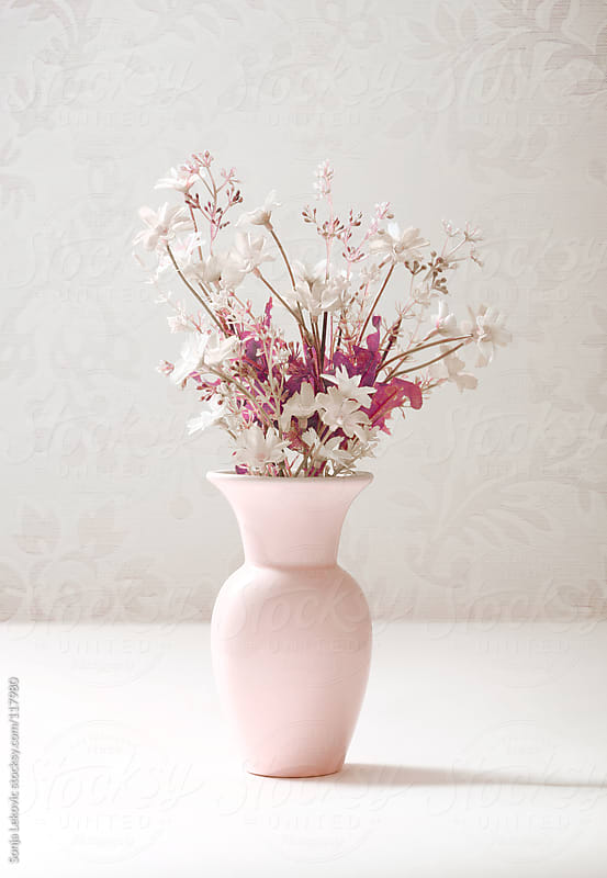 pastel pink vase with white flowers by Sonja Lekovic for Stocksy United