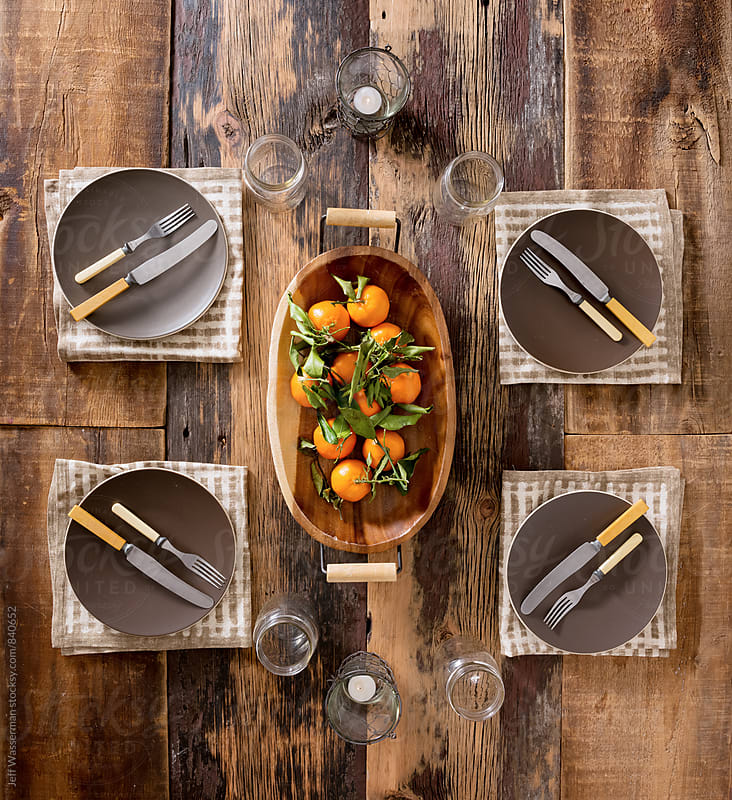 Rustic Table Setting with Clementine Oranges by Jeff Wasserman for Stocksy United