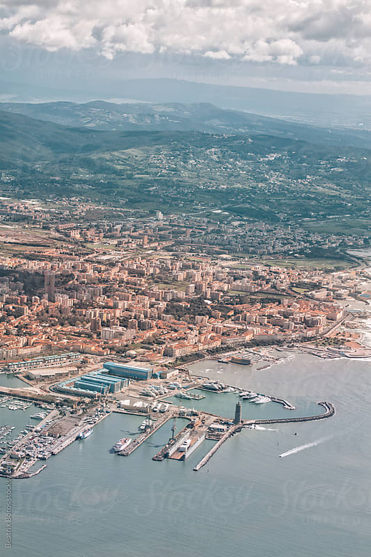 Bird's eye view of a busy port by Beatrix Boros for Stocksy United