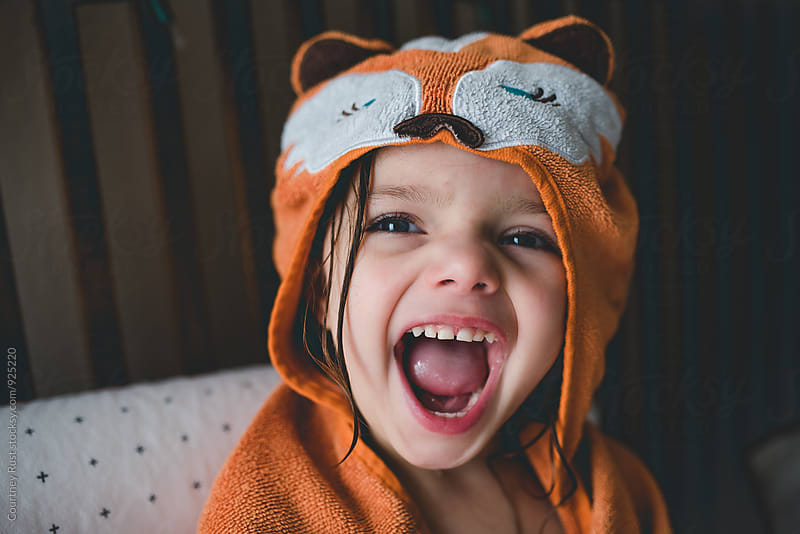 Roaring after a bath  by Courtney Rust for Stocksy United
