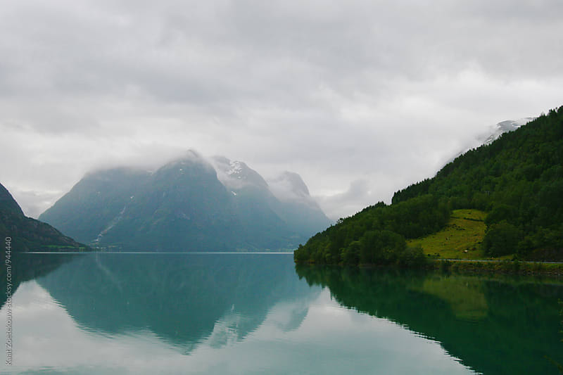 Norwegian landscape reflected in a lake by Kaat Zoetekouw for Stocksy United