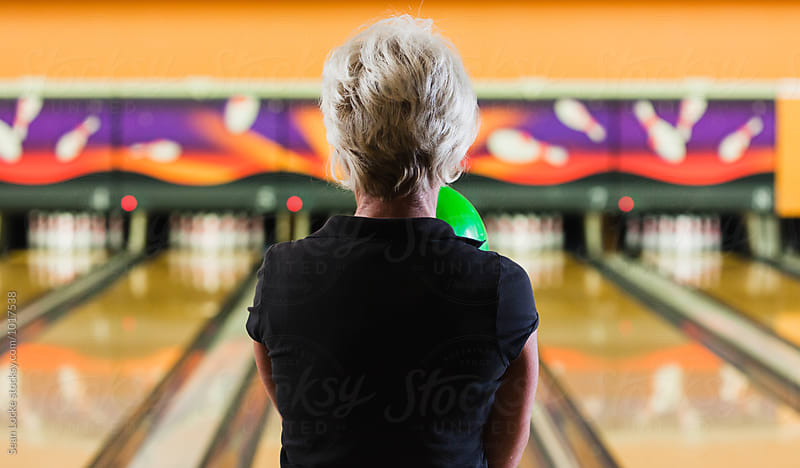 Bowling: Rear View Of Senior Woman Ready To Bowl by Sean Locke for Stocksy United