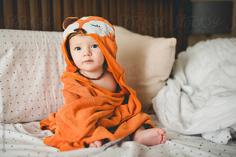 foxy boy in towel by Courtney Rust for Stocksy United