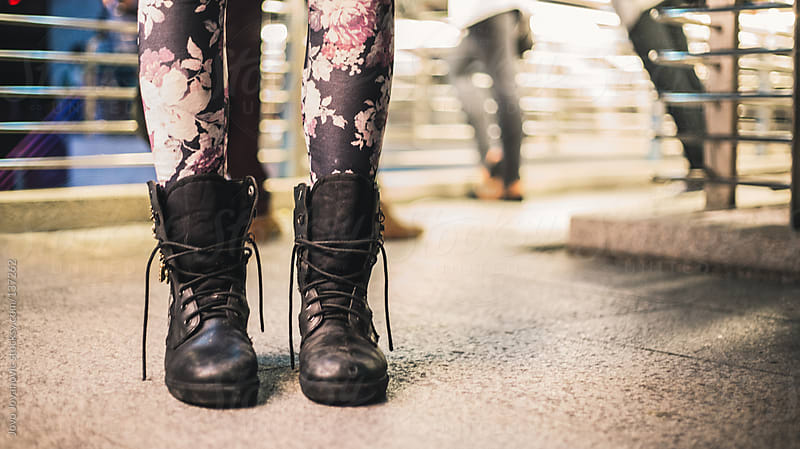 Feet of a woman wearing leather boots. by Jovo Jovanovic for Stocksy United
