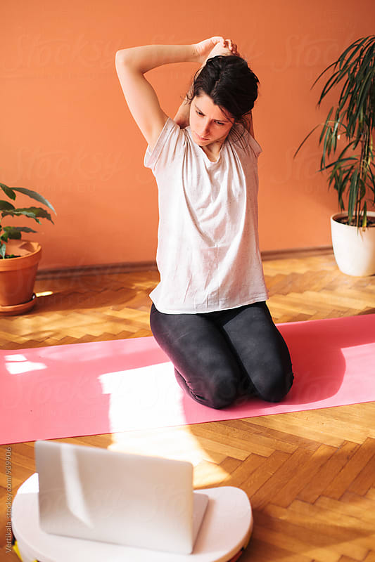 Woman doing yoga indoor by Marija Mandic for Stocksy United