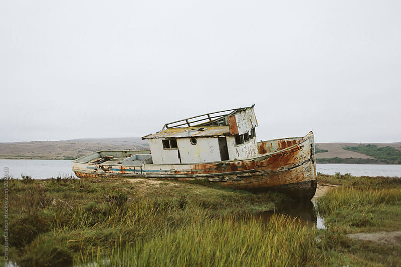 Abandoned shipwreck near Bolinas, CA by Christian Gideon for Stocksy United