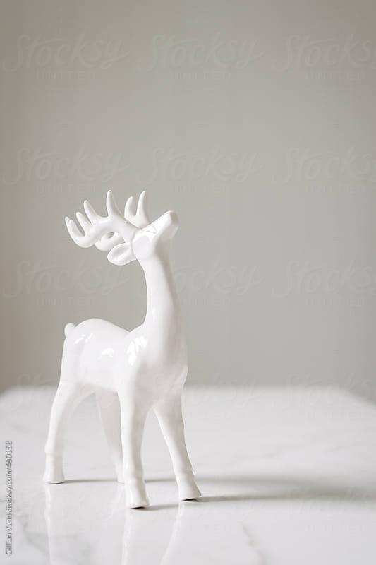 white reindeer ornament for christmas by Gillian Vann for Stocksy United