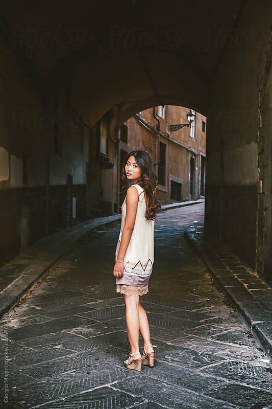 Fashionable Young Asian Woman in a Dark Alley by Giorgio Magini for Stocksy United