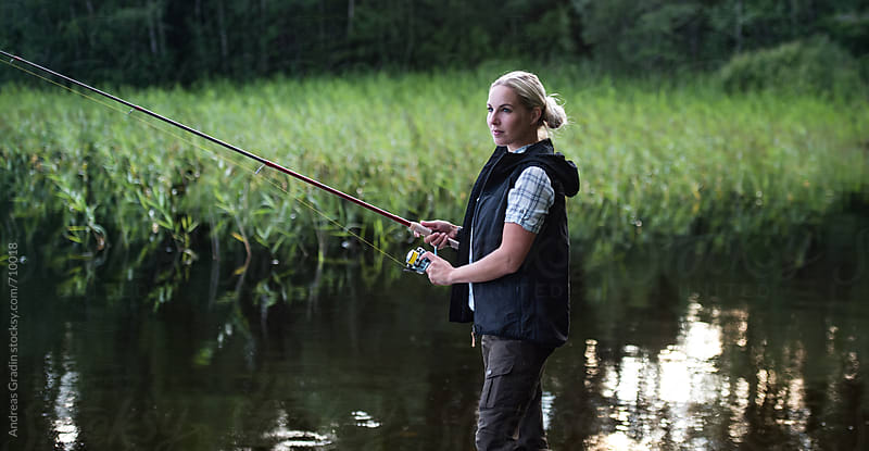 fishing woman by Andreas Gradin for Stocksy United