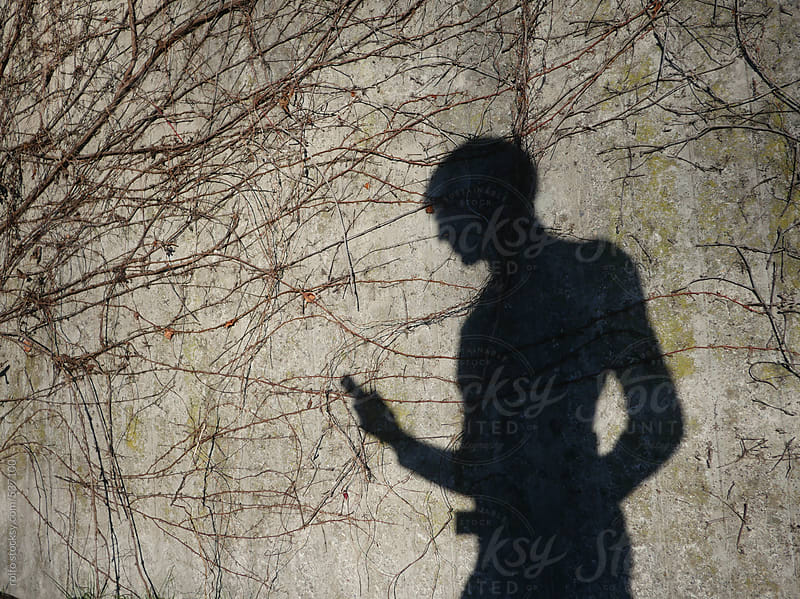 shadow smartphone, mobile, phone,  man wall by rolfo for Stocksy United