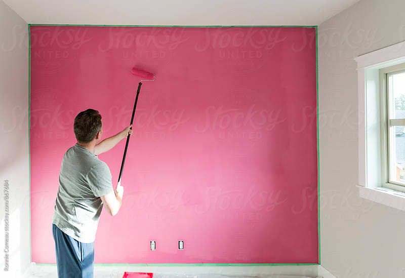 Man Painting A Wall Pink by Ronnie Comeau for Stocksy United