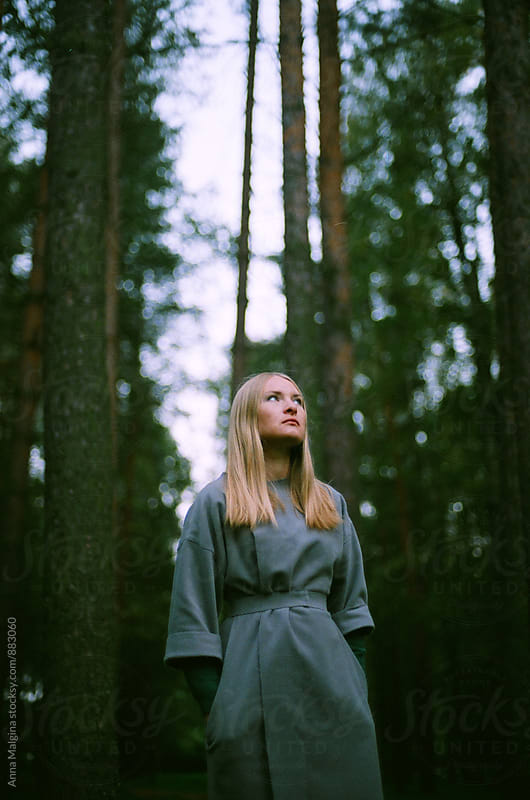 A film portrait of young beautiful blond woman in the forest by Anna Malgina for Stocksy United