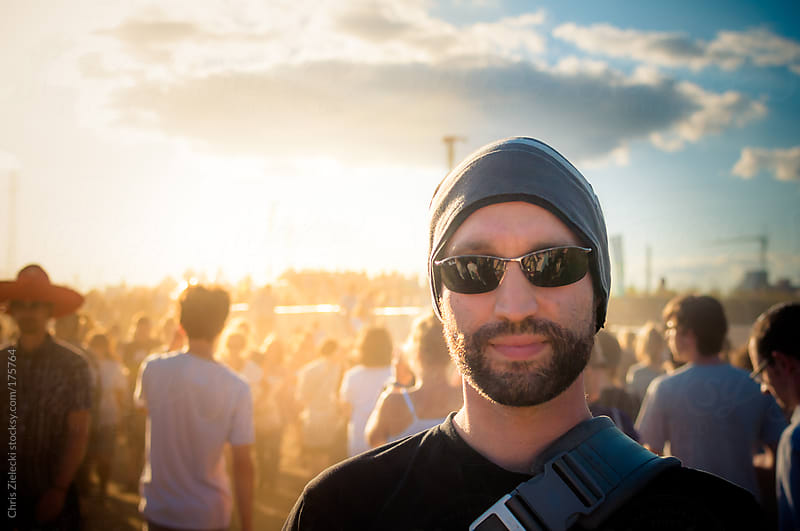 guy with beard on a festival by Chris Zielecki for Stocksy United