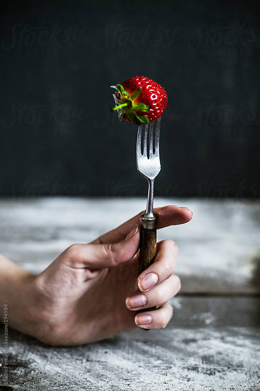 Strawberry on the fork by Studio Firma for Stocksy United