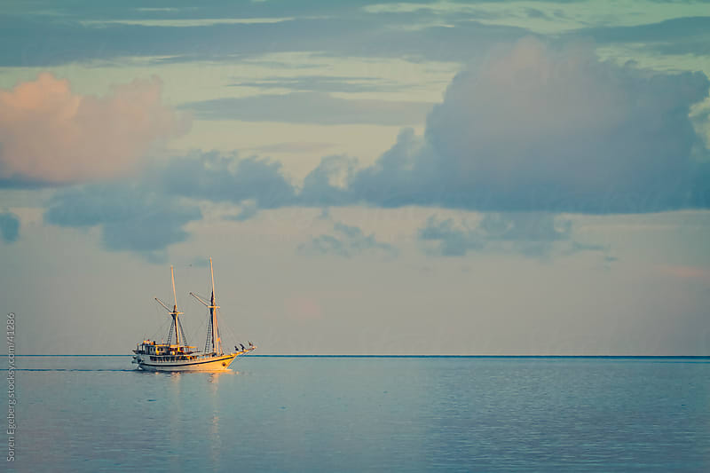 Sail boat cruising the open calm ocean  by Soren Egeberg for Stocksy United