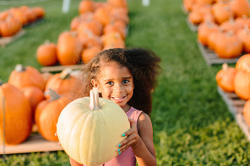 Little Girl at the Pumpkin Patch by Kristen Curette Hines for Stocksy United