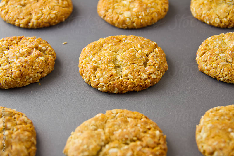 ANZAC biscuits coat cookie on baking sheet by Kirsty Begg for Stocksy United