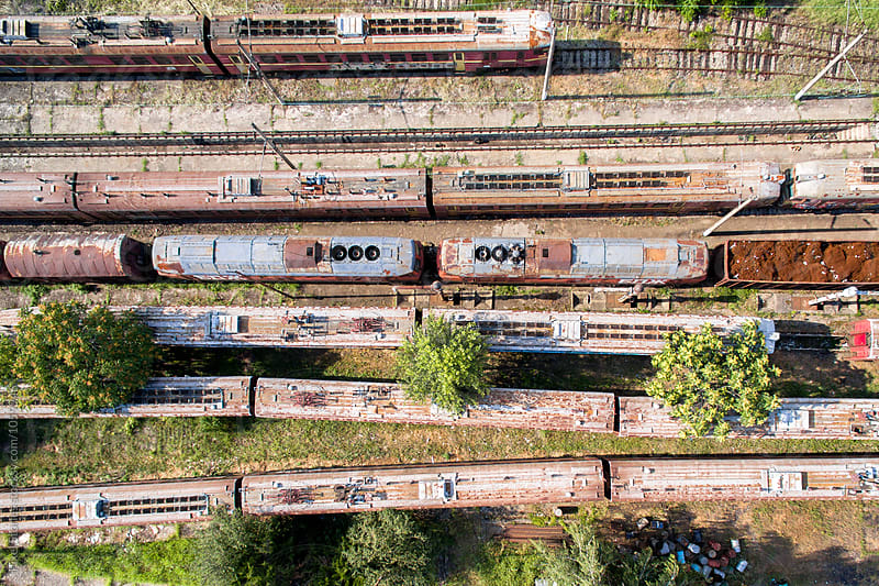 Old railway cars from above by Pixel Stories for Stocksy United