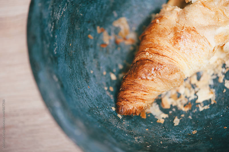 Fresh croissant from overhead by Adrian Cotiga for Stocksy United
