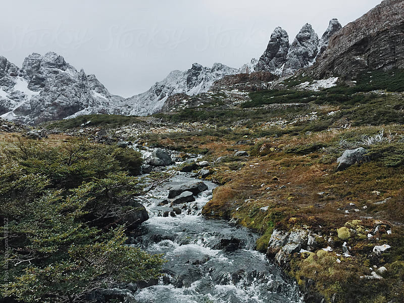 Moody Mountains and Creek by Kevin Russ for Stocksy United