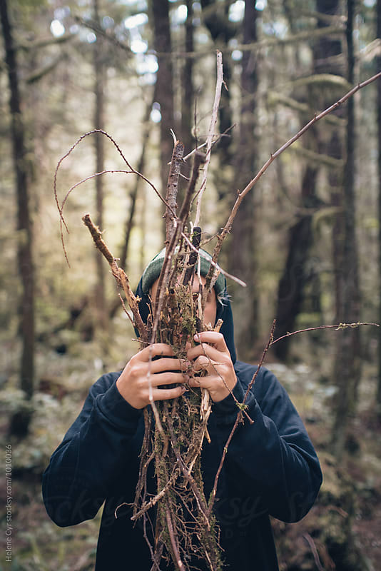 Hiding behind twigs by Helene Cyr for Stocksy United