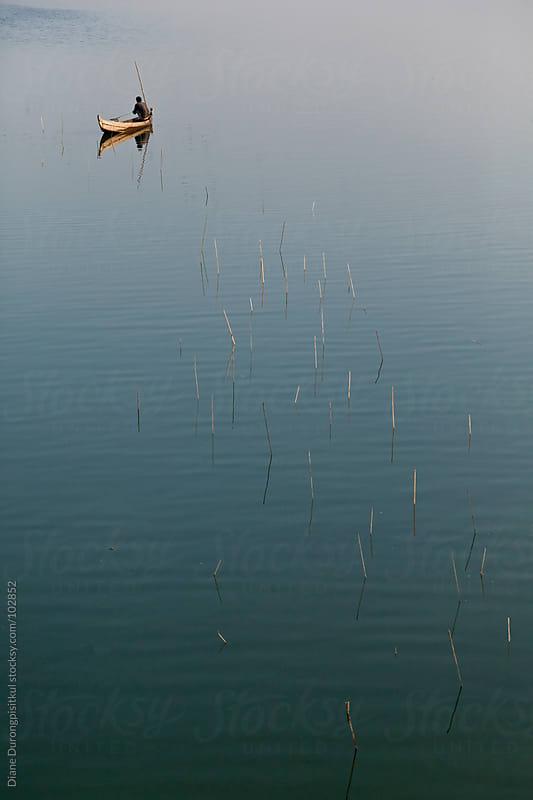 Lone Fisherman by Diane Durongpisitkul for Stocksy United