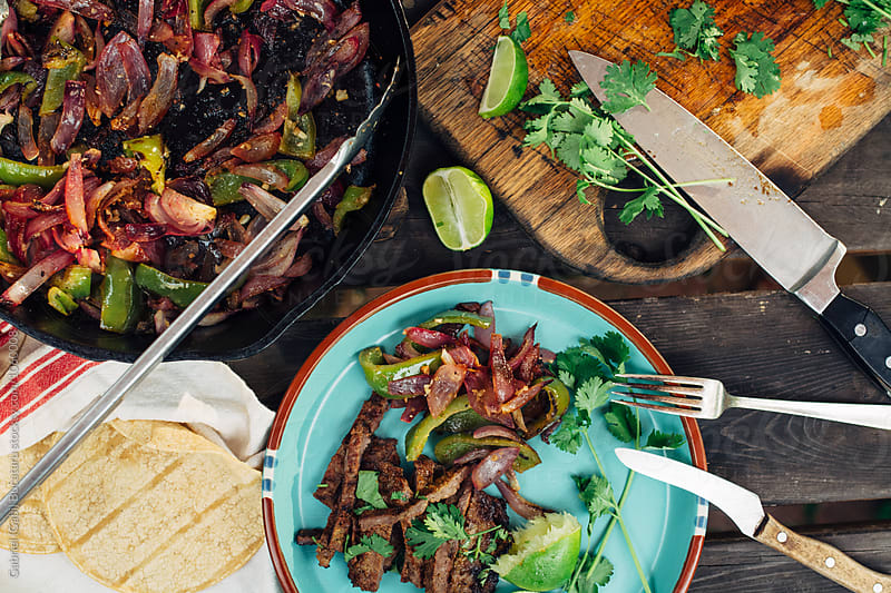 Grilled beef fajitas on a plate from above by Gabriel (Gabi) Bucataru for Stocksy United