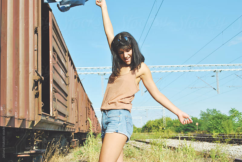 young girl at the railway by Jovana Vukotic for Stocksy United