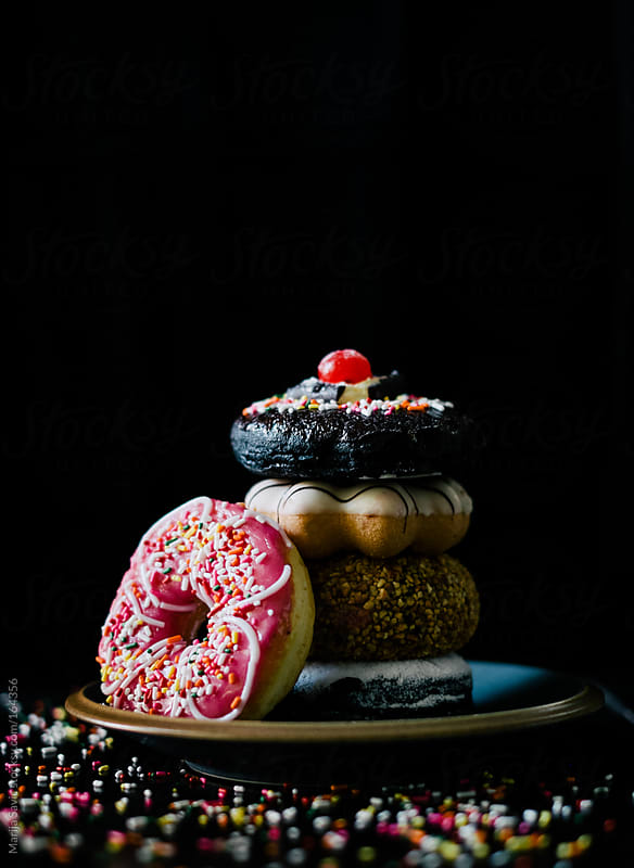Donuts with Different Icing and Colorful Sprinkles  by Marija Savic for Stocksy United