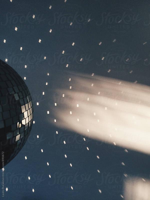 Disco ball and ray of light by Liubov Burakova for Stocksy United