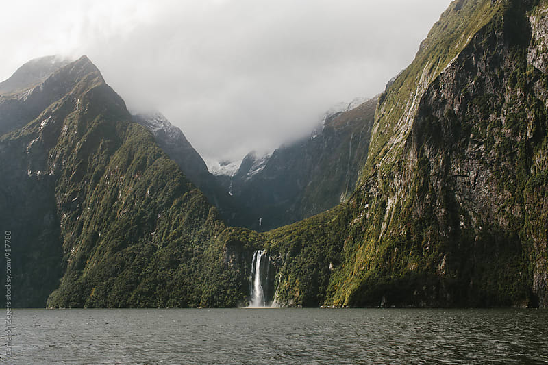 Waterfall at Milford Sound, New Zealand by Cameron Zegers for Stocksy United