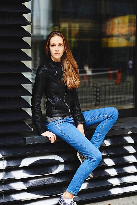 blonde girl posing in the city by Atakan-Erkut Uzun for Stocksy United