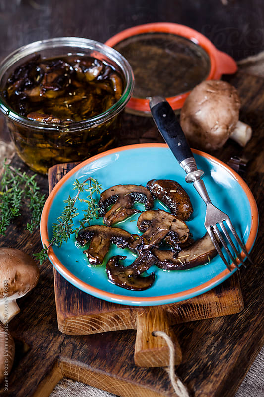 Marinated mushrooms by Susan Brooks-Dammann for Stocksy United