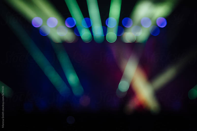 Blurred laser lights at an indoor gig by Maresa Smith for Stocksy United