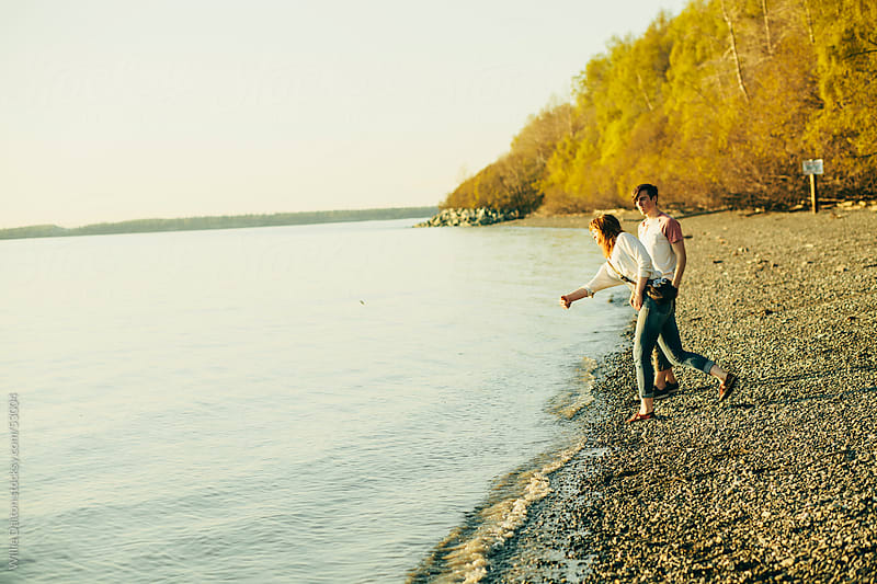 Skipping Rocks into Ocean by Willie Dalton for Stocksy United