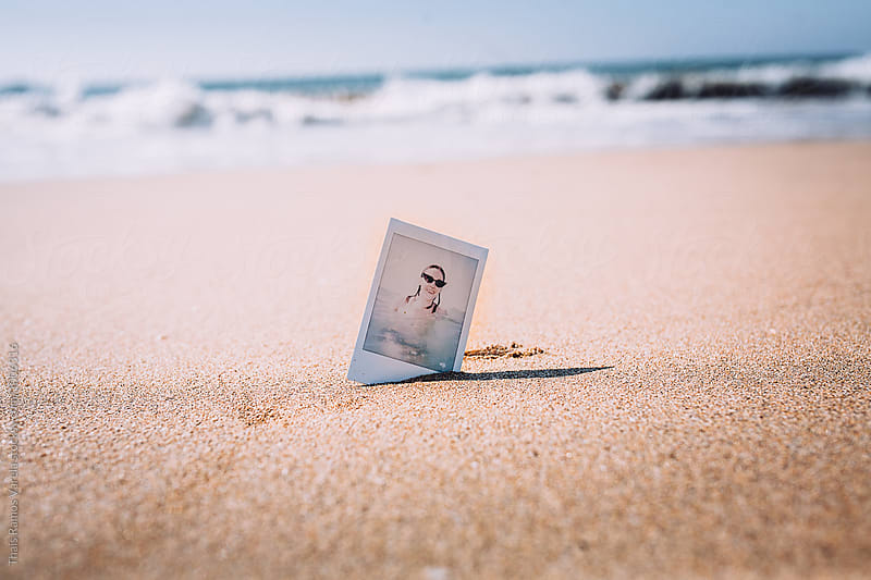 polaroid on the beach by Thais Ramos Varela for Stocksy United