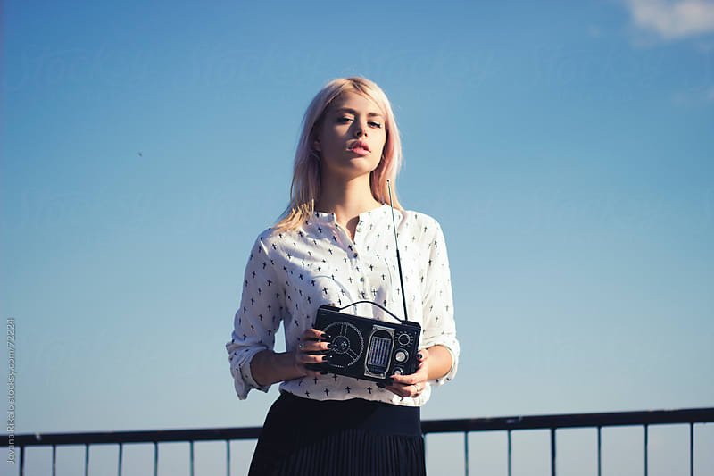 Model posing in urban surroundings. by Jovana Rikalo for Stocksy United