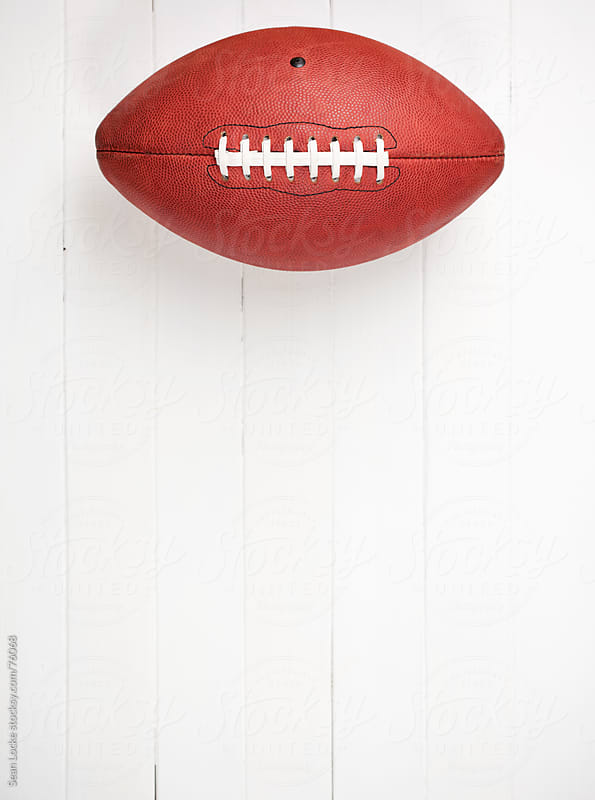 Football: Ball Alone on Wooden Background by Sean Locke for Stocksy United