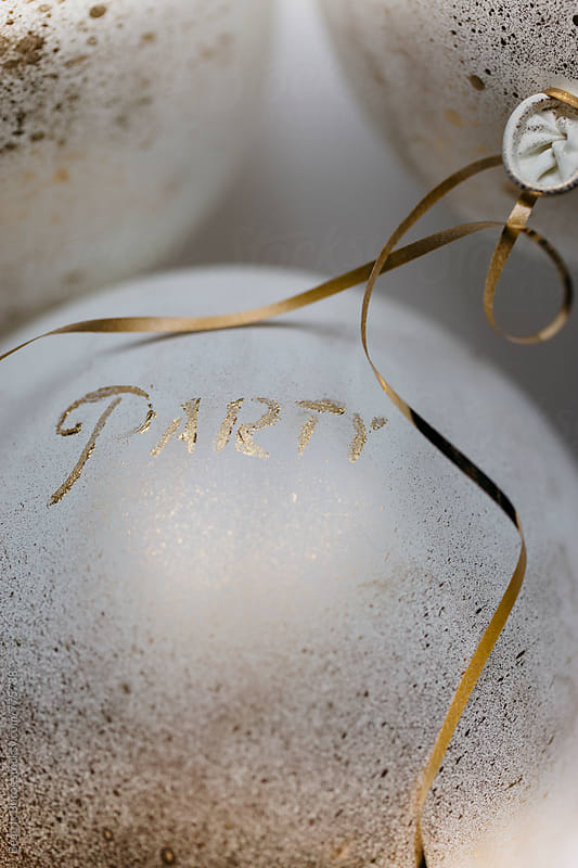Word party written with golden paint on a white balloon  by Beatrix Boros for Stocksy United