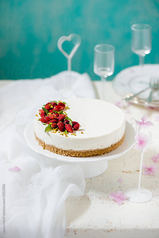 Cheesecake with wild strawberries by Laura Adani for Stocksy United