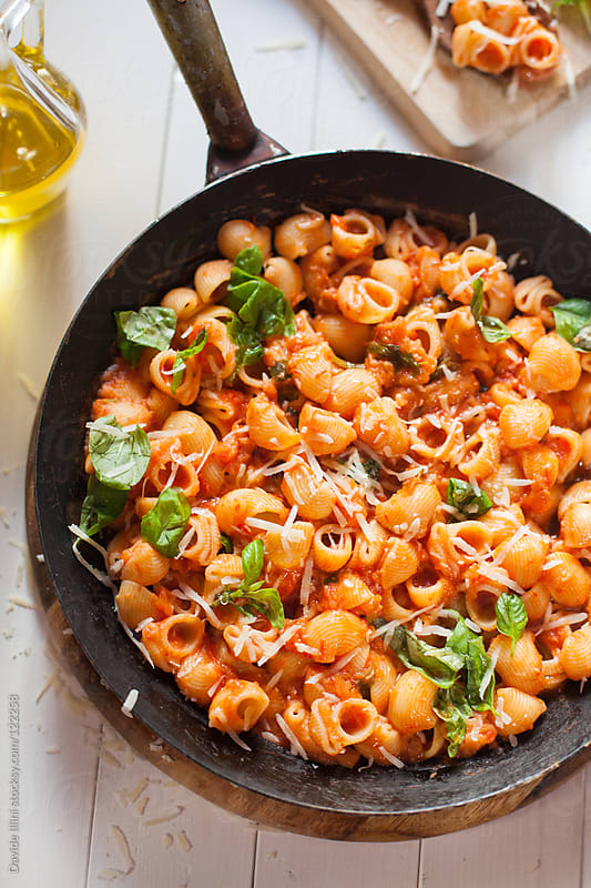 Pasta with tomato sauce and basil by Davide Illini for Stocksy United