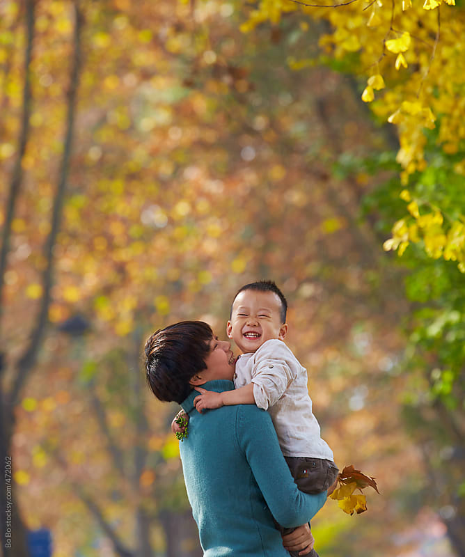 happy little boy with his mother outdoor in the autumn park by Bo Bo for Stocksy United