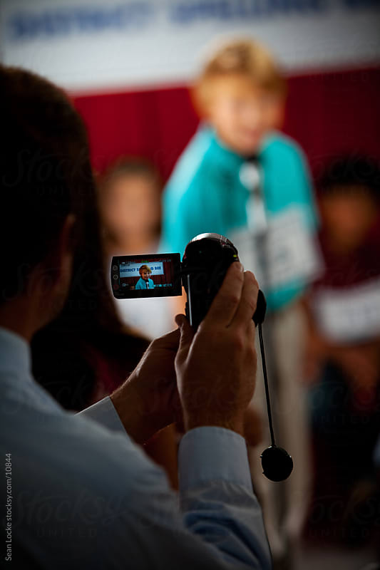 Spelling: Focus on Parent Videotaping Child by Sean Locke for Stocksy United